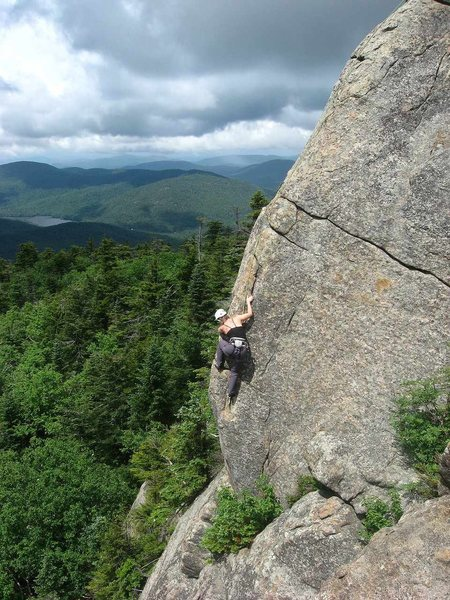 Climber works her way up Rock of Ages.