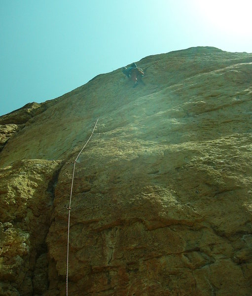 Near the end of the bulging crux. Photo by Paul Rezucha.