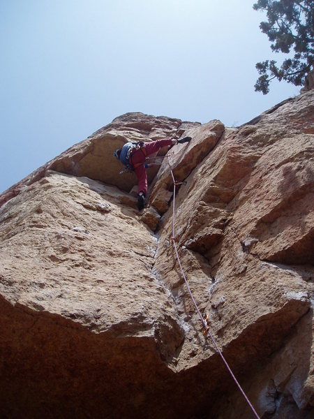 Pulling around the crux roof. Photo by Paul Rezucha.