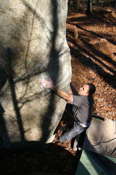 Joe McLoughlin working on the Back Corner Arete.