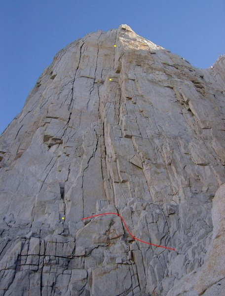 29aug09, we did it like this.  Red line denotes our approach to 4th class ledge, three yellow dots show our belays, pitches.  Second belay station (at 2nd dot) out of view at base of dihedral corner.<br> <br> Check out the distorting effect of the photo:  Second pitch (200') is actually almost as long as first pitch (215')!