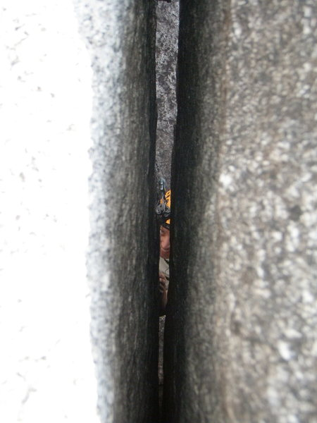 Looking down through the crack from the belay.