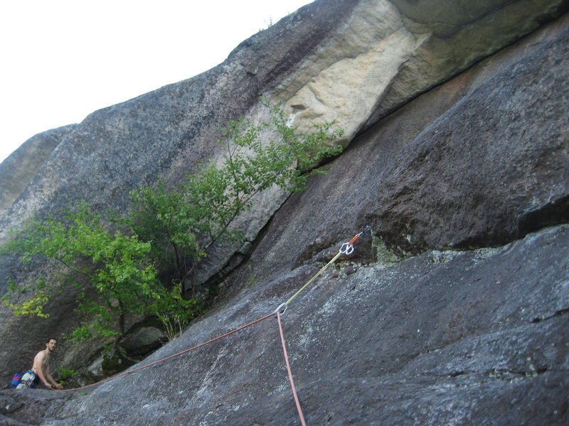 Myself standing at the belay, to give some perspective on the size of the roof.<br> <br> Photo by Matt Ritter.