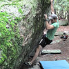 "Aaron Parlier crimping through ""Blue Jet"" (V-2) on the Olympus Boulder."