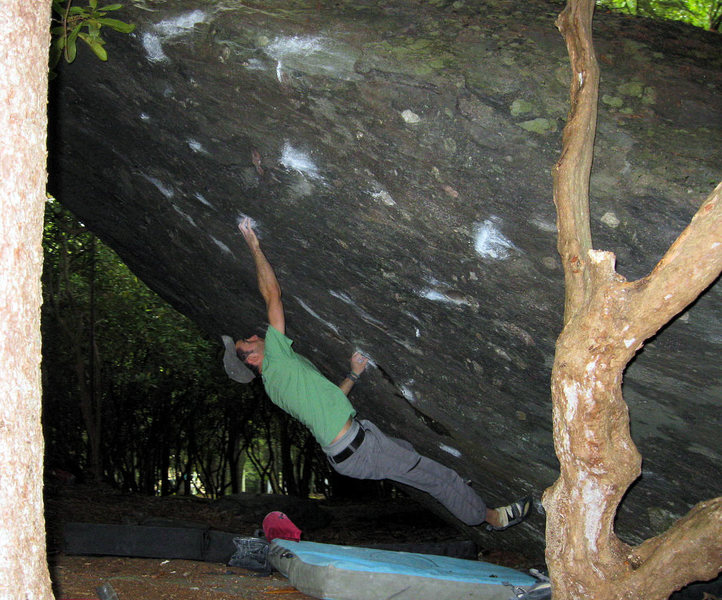 "Aaron Parlier past 45 on ""Athena"" (v7) on the Olympus Boulder"