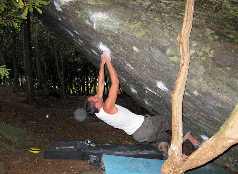 "Steve Lovelace feeling the reverberations from ""Aftershock"" (V-6) on the Olympus Boulder"
