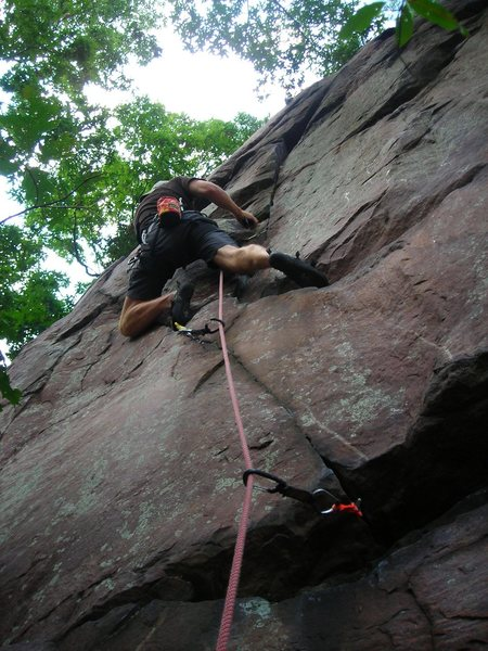 """Nick Rhoads leading """"Mancation"""" Red Nose Wall area West of the Quarry Rocks East Bluff Devils Lake 9-05-09."""