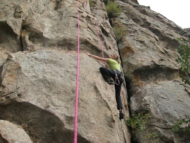 Kristie McNamara climbing on huecos and chickenheads.