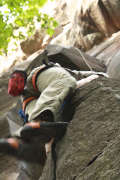 Rock Climbing Photo: Derrick cleaning Sheer Energy.