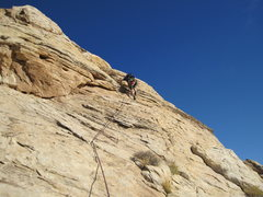 Rock Climbing Photo: Crossing the slab on pitch 3 to the central groove