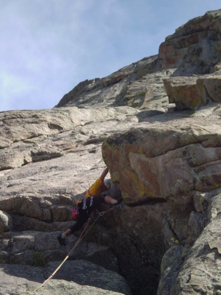 Rock Climbing Photo: P1 moving over a bulge into the left-facing dihedr...