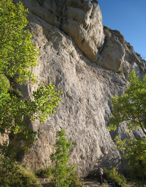 The central, money section of the Cowboy Poetry cliff on a warm Indian Summer morning.<br> <br> Take Your Had Off Boy begins just left of the climber, and Buffalo Soldier begins just to the right (around the bushes).