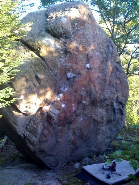 The other main boulder at the top of the Little Agassiz area. The V2 Face Problem starts on the jug on the lower left and follows the chalk to a slopey top out. The Right Arete is easier than it looks in this photo. <br>