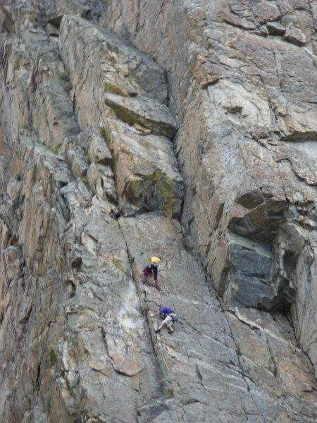 Amanda Moyer belaying Ken Jern on Monkeyflower. The crux second pitch of Triple Roofs can be seen above and slightly right of Moyer.