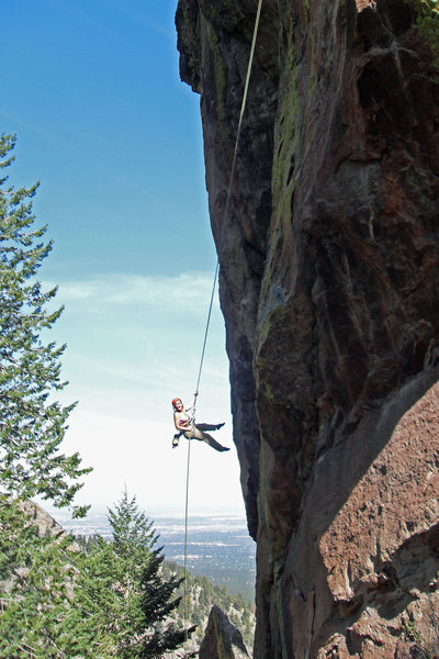 Brenda on the long, vertical second rappel.