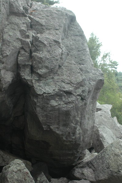 Group Leader climbs up the steep prow.
