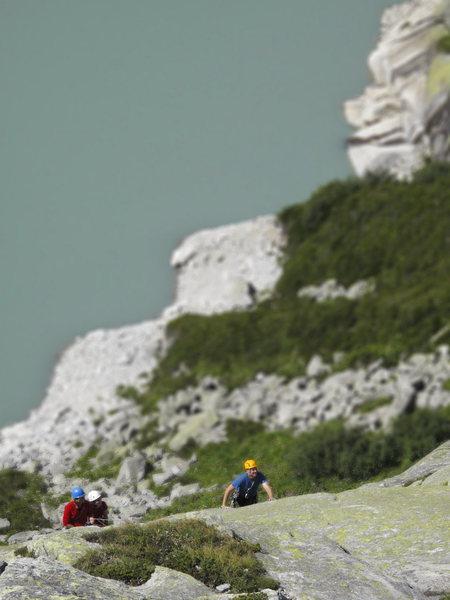 Bernhard Streicher climbing Wassersinfonie (5b**), on the Albigna Hut slabs.