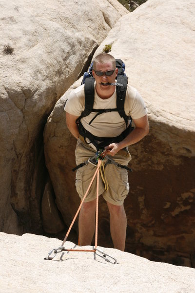 Rappelling in J-Tree.  Note: Completely unnecessary knife in the mouth. (Back of Turtle Rock)