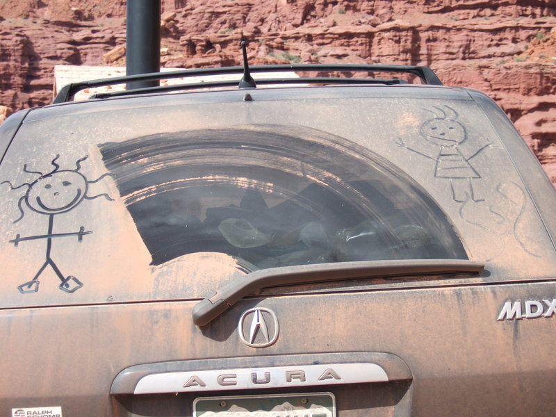 Petroglyphs left on our car by an unknown Anasazi Artist.