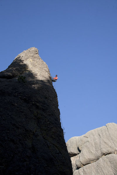 Rock Climbing Photo: HJ Schmidt rappelling off Riddle on the 5.10 side....