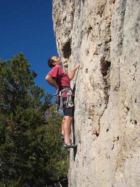 Climbing the attractive headwall of War Paint.