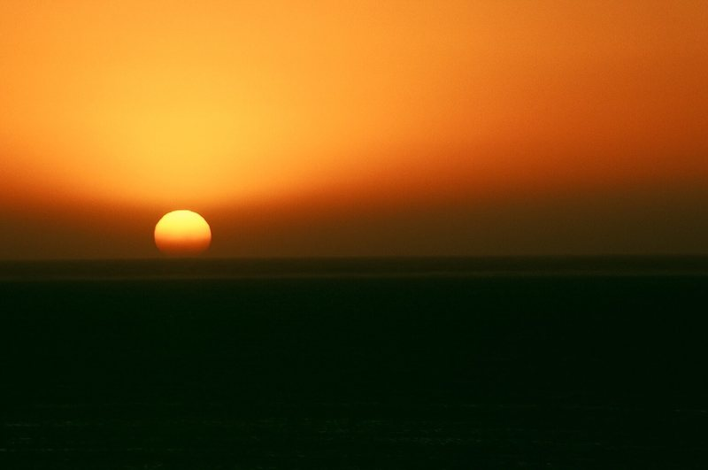 The sun sets into the Indian Ocean.