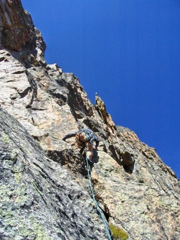 "Roland starting up the ""original finish"" after traversing directly right from the belay notch at the top of P2."