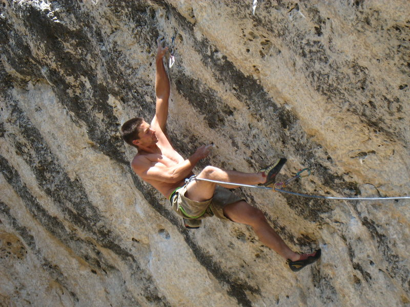 "The sidepull mono move on Cow Reggae.  <br> <br> BJ is actually working the heinous linkup ""Genetic Drifter"" which climbs all but one move of Cow Reggae after blitzing the cruxes of the 13c & 14a to the right!"