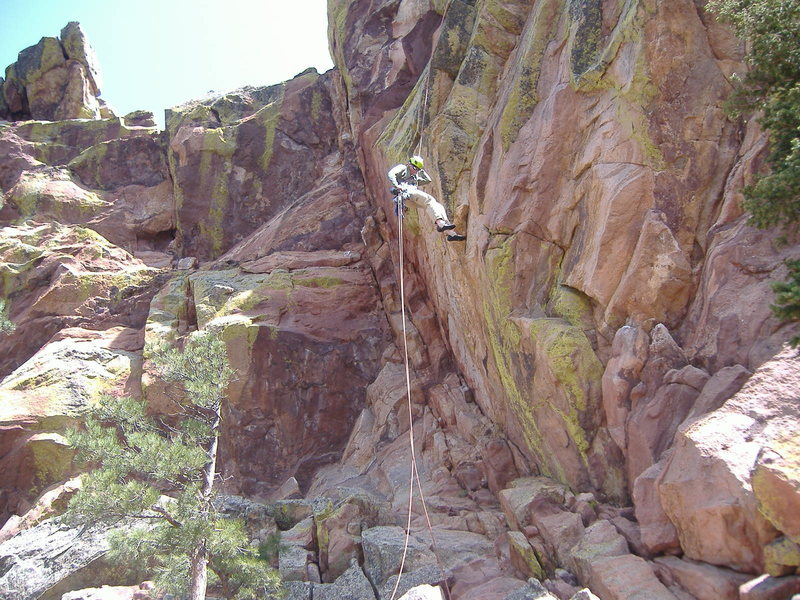 Rock Climbing Photo: Rick rappelling off the back of Flatiron 1