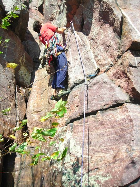 """Dmitriy about to pull the mantle move on this unnamed 5.7 just back from and behind to the right of """"No Sweat"""" overhang route."""
