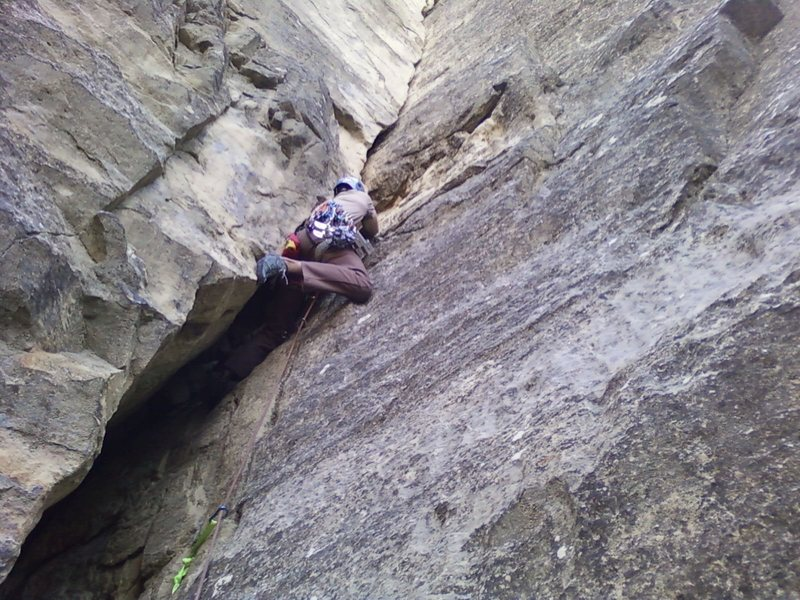 Jared doing the crux of the Cave Route.