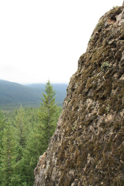 Rock Climbing Photo: The top 15 ft. of rock is broken, covered in moss,...
