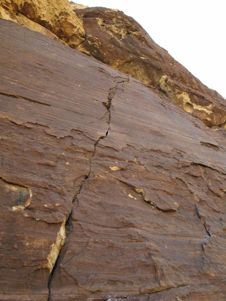Pitch 10: a crack leads to a roof. This is the crux pitch of the upper route.