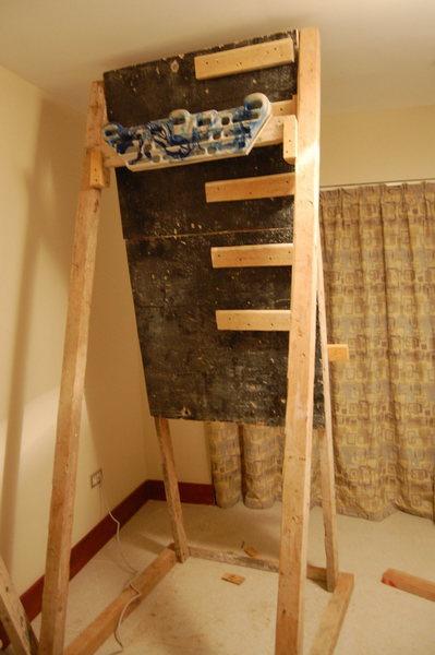 Campus board with hangboard attachment.