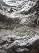 Rock Climbing Photo: Aid climbing a bolt ladder at Millard Canyon Falls