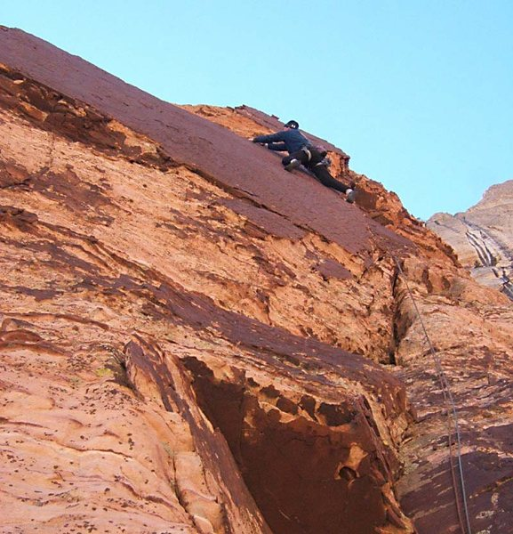 An airy move to the left on the traverse.