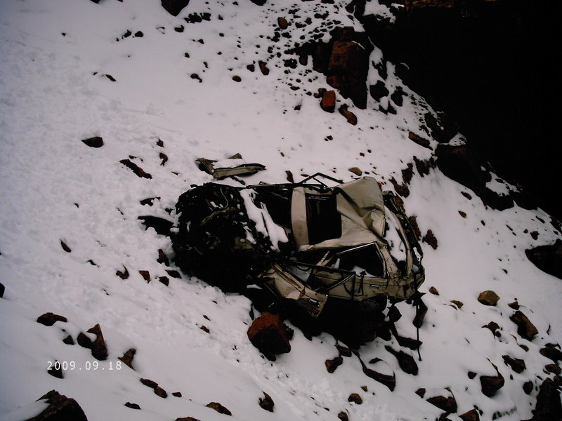 A car in the left Col driven off the summit by a suicidal teenager. He lived, believe it or not.