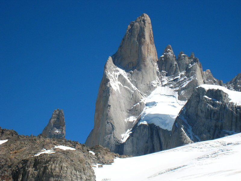 The East Face of Poincenot. The Whillans Route follows the obvious snow ramp to the shoulder between the East & South faces. The upper, rock section is around the corner to the left on the upper South face.