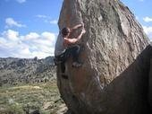 Climbing a route in the Buttermilks, V2, maybe, its a warmup.