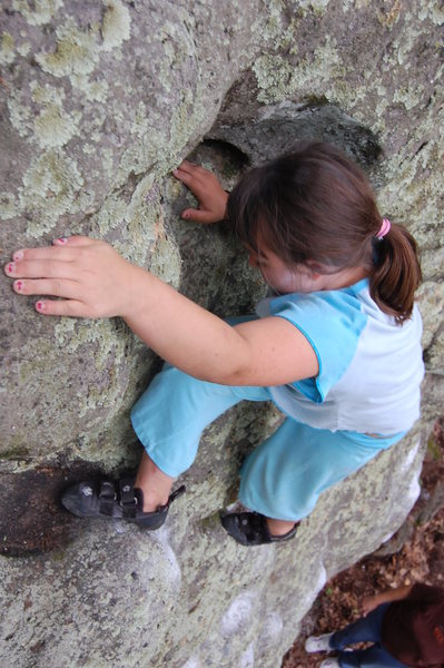 Kianna (9) topping out on one of her problems.