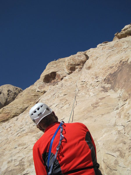 Chris belaying Lance at the top of P3