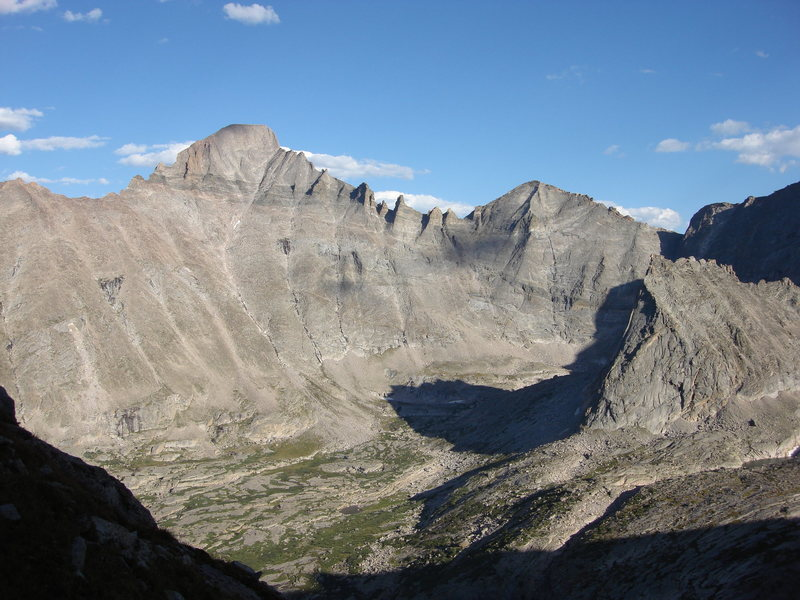 This is upper Glacier Gorge as seen from Arrowhead rather late in the day and late in the summer.  The view is facing southeast and includes Longs Peak, Keyboard of the Winds, Pagoda Mountain and Spearhead. The East Ridge of Chiefs Head Peak climbs out  of the frame to the right.