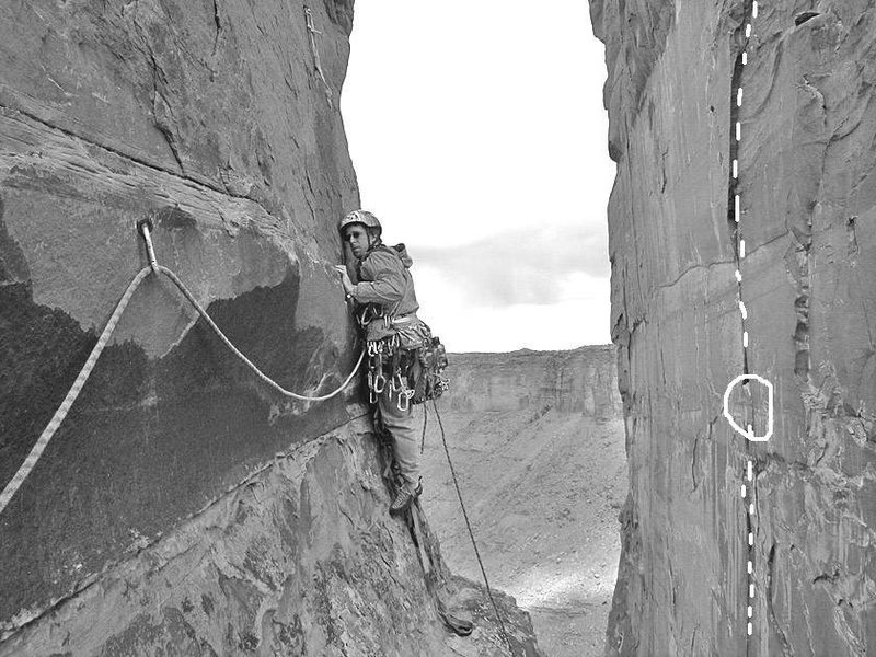 This is a copy of Brad Brandewie's photo of Ian McAlexander on Dolomite Tower, Kor Route.  <br> <br> Much of the third pitch of Infrared is marked (white dashes).  <br> <br> Josh Janes's description mentions a bolt protecting a loose block (white circle).  The belayer is pinned in place by two bolts directly under it.  When my turn  came to yank on it...it felt pretty good.  Whew!