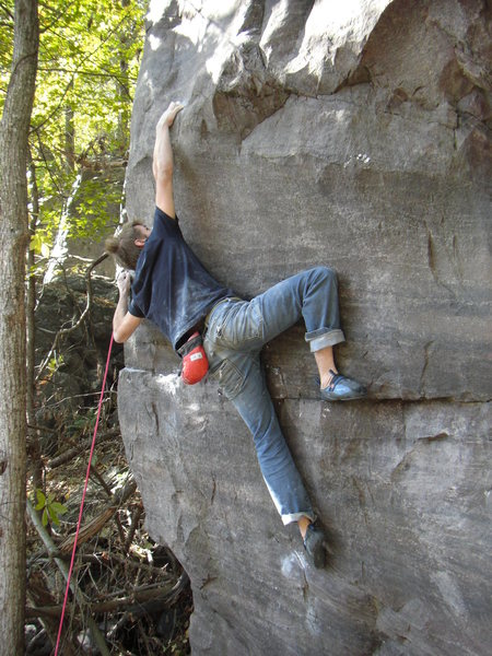 Making the long reach after sticking the crux move.