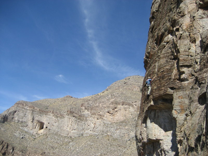 Grady Viramontes on one of the steep lines. The bat cave is visible across the canyon in the back-ground.