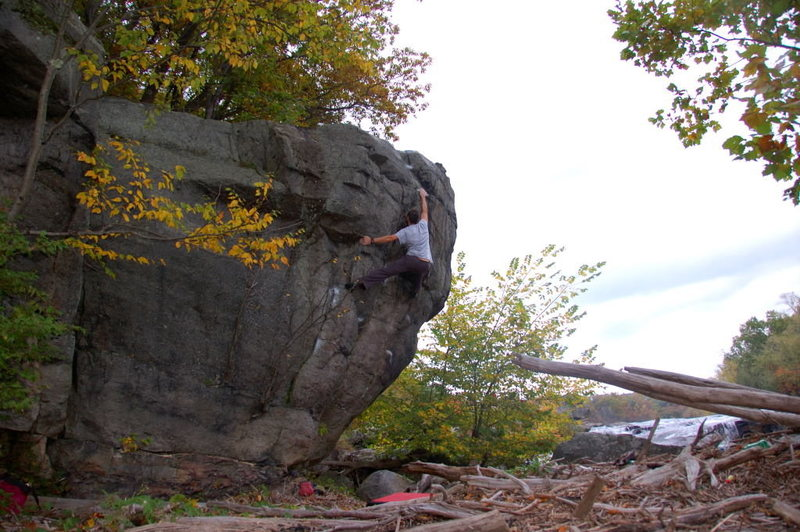 Myself sending Fallside V5 an incredible boulder problem in an amazing setting.  Located on the Prow block directly across from the observation deck at Ohiopyle State Park, PA
