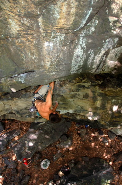 Jeremy Steck resting after the crux moves during the first ascent of Prince of Darkness 12c Ohiopyle State Park, PA
