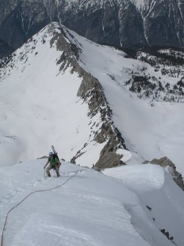 Classic snow climbing on the upper ridge with Hogum Divide beyond.