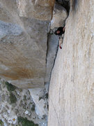 Rock Climbing Photo: Cleaning a piece at the start of the layback.