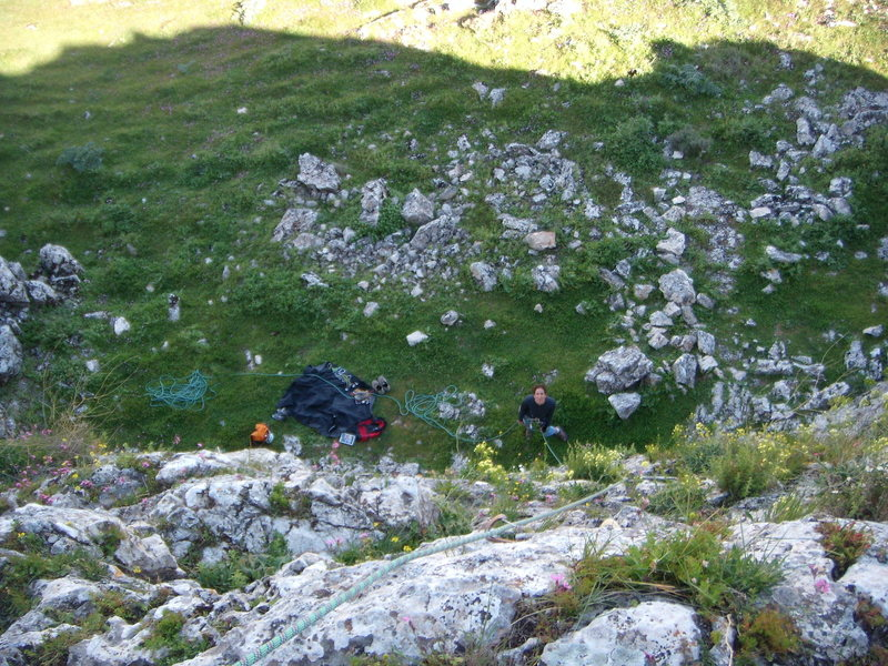 Looking down from the anchors of Profecia and Nostradamus. Very comfortable to belay from the grass.